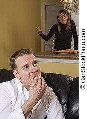 couple arguing in apartment