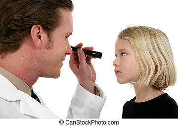 Eye Doctor And Patient - Eye doctor examining young girl...