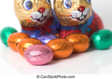 Easter bunnies watching the easter eggs - Chocolate eggs and...