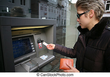 woman outdoor - pretty woman outdoortaking cash from an atm...