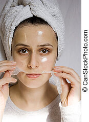 facial peel - portrait of young woman with beauty mask