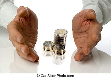 business - eur coins between business men hands concept