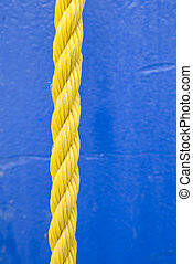 Yellow Rope on Blue Background - Yellow rope on blue...