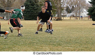 Flag Football - Young men playing flag football in a park