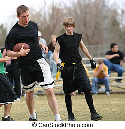 Flag Football - Flag football players with the football