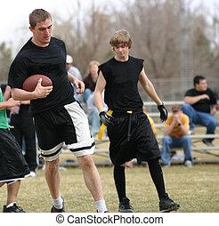 Flag Football - Flag football players with the football