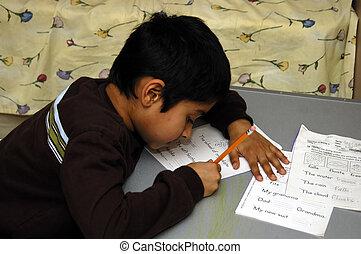 Kid doing homework - A Kid diligently doing his school...