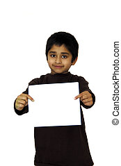 Kid holding a sign - A young gentleman holding a sign board