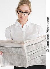 Businesswoman reading financial newspaper - A businesswoman...