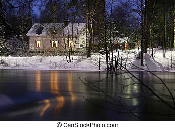 Winter - A house on the banks of a river