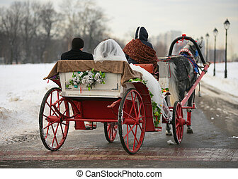 Wedding - The groom and the bride in a vehicle with red...