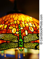 Dragonfly on a lamp - Dragonfly: part of a stained-glass...