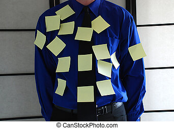 post-it man - businessman standing with alot of post-its on...