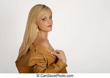 Jacket - A blonde woman taking off her jacket