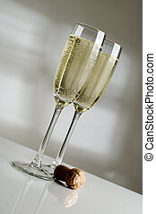 champagne - Two champagne glasses filled with sparkling...