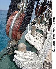 Sailing - closeup of ropes on a old sailing boat