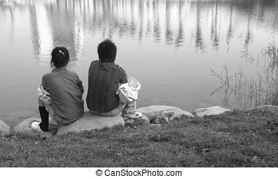 Silent Asian Couple - -- sitting by the side of a lake...