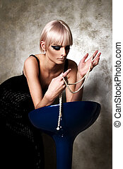 Woman with pearls - Young woman playing with pearls