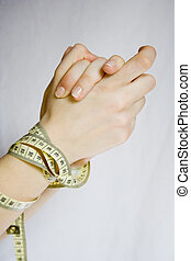 Diet problem - hands tied up with measure tape. diet issue