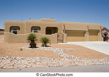desert home - southwestern style house with rock garden...