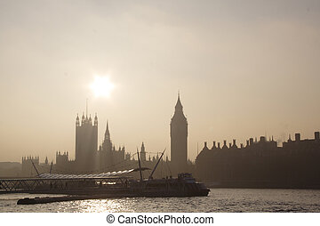 London skyline in foggy day with sun (Parliament)