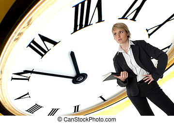 time - business woman standing with clock in background...
