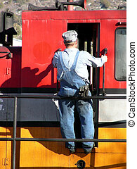 Hitching a Ride - Train engineer climbing into a diesel...