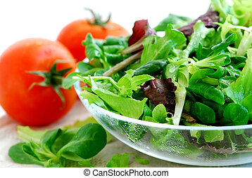 Baby greens and tomatoes - Fresh baby greens salad and...