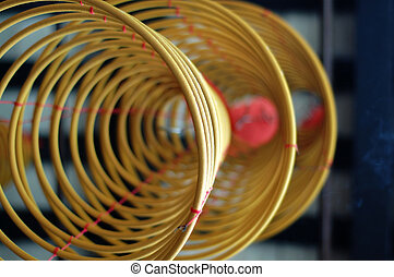 Three big incense coils