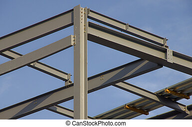Structural steel girders against blue sky
