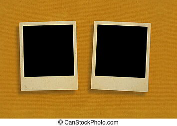 two old photo frames against rough paper