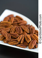 Peacans in a contempory bowl - pecans whole in a contempory...