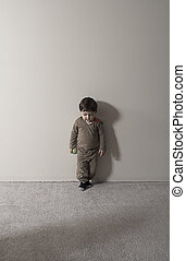 lonely boy - little baby playing alone with ball in his hand