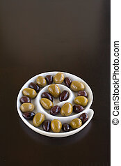 Olives in spiral dish - Green and Black olives in a sprial...