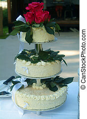 Wedding cake - A wedding cake with flowers on top