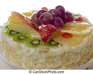 Fruit pie with an apple an orange a grapes and kiwi