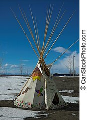 Blackfoot tepee in Calgary Alberta, with rocky mountains in...