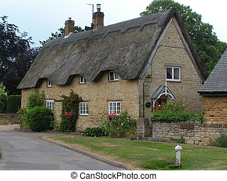 thatched house - A large old thatched house in a middle...