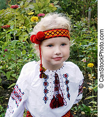 Ukrainian - Little girl in Ukrainian national suit on flower...