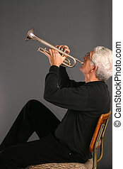 Man with a Trumpet - Old man sitting in a cane back chair...