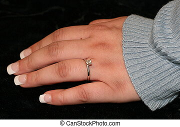 Engagement Ring - A young womans hand with diamond...