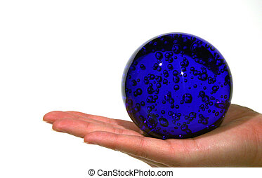 In Your Hands - An open hand holding a blue globe