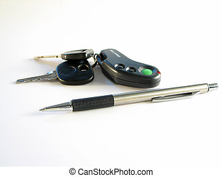 Pen and car keys - pen and car keys on the white background...