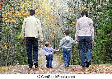 Walking family - A family walking through the woods