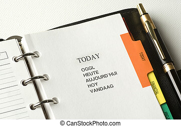 planner - note book with pencil close up shoot