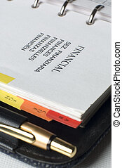 financial - note book with pencil close up shoot