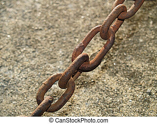 Chained - A close-up of a some rusty old chain links.