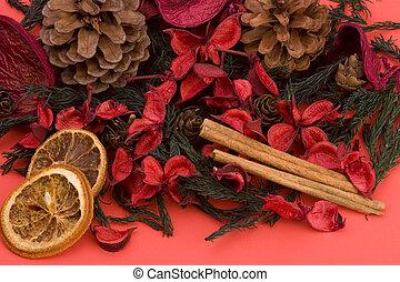 Mandarin,Cloves & Cinnamon pot pourri against a plain...