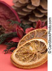 Mandarin,Cloves & Cinnamon pot pourri against a plain...