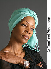 Woman Wearing Scarf - Woman wearing light colored scarf and...